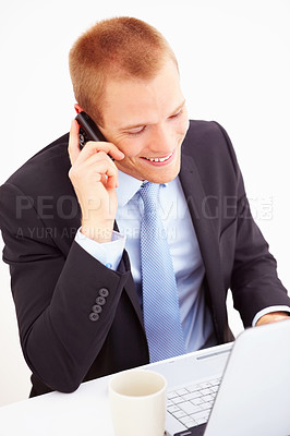 Buy stock photo A smart business man sitting in office with computer, using a mobile