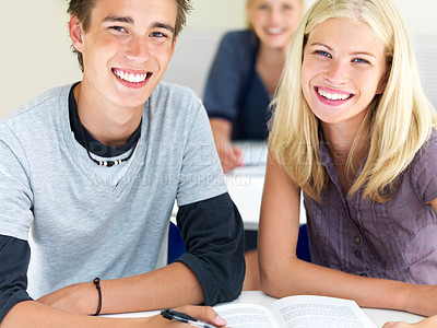 Buy stock photo Closeup of happy young boys and girls sitting together in class with notes