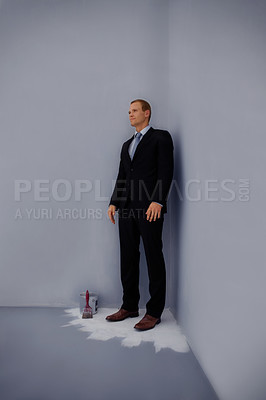Buy stock photo Full length of a business man standing trapped at the corner of a fresh painted floor