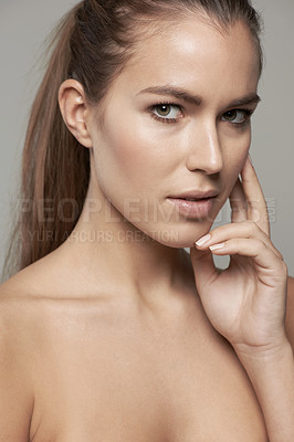 Buy stock photo Cropped shot of a beautiful young woman against a gray background