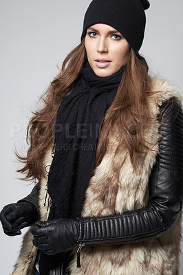 Buy stock photo Gorgeous young woman dressed in luxurious winter fashion