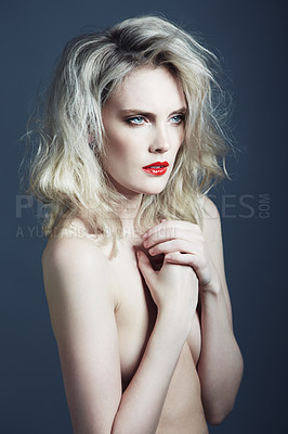 Buy stock photo Studio shot of a gorgeous young woman posing in the nude against a gray background