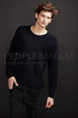Buy stock photo A young man with elegant facial features wearing the latest in winter fashions