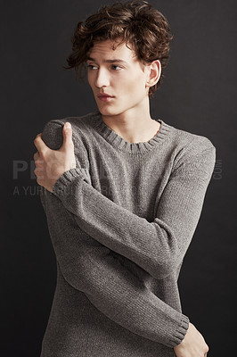 Buy stock photo A young man with elegant facial features wearing a woolen jersey and looking away thoughtfully