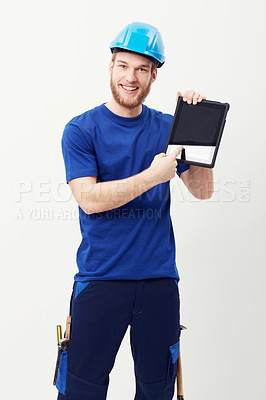 Buy stock photo Portrait of a happy young man showing you a digital tablet
