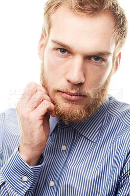 Buy stock photo Portrait of an unshaven young man touching his beard isolated on white