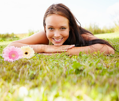 Buy stock photo Portrait of a cute young female lying on grass field