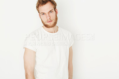 Buy stock photo Portrait of a young man wearing a white t-shirt