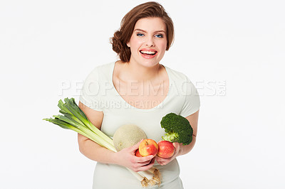 Buy stock photo Pretty brunette woman holding some healthy fruit and veg