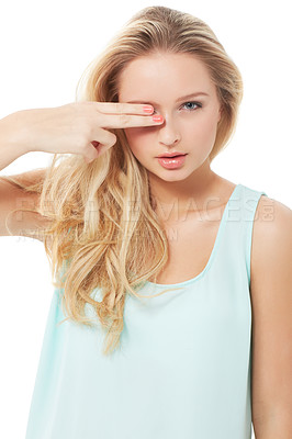 Buy stock photo A pretty young woman snipping her fingers over her eyes while isolated on white
