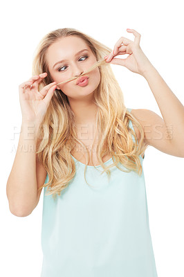 Buy stock photo A quirky young beauty using her hair as a moustache while isolated on a white background