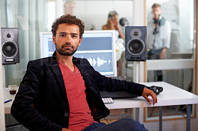 Buy stock photo A handsome young audio engineer sitting in his studio