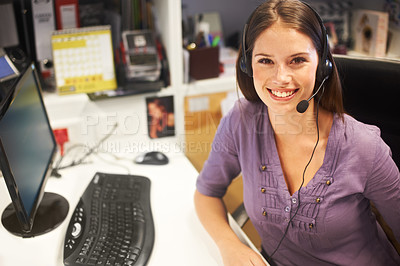 Buy stock photo Cropped portrait of a young businesswoman wearing a headset at her desk