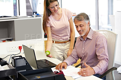 Buy stock photo Cropped shot of young businesswoman assisting a male coworker
