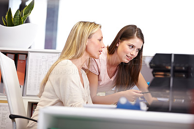 Buy stock photo Cropped shot of two female coworkers working in the office
