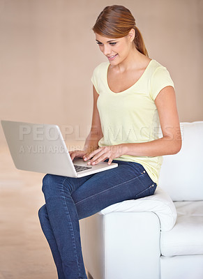 Buy stock photo A happy young woman enjoying an online chat with her friends