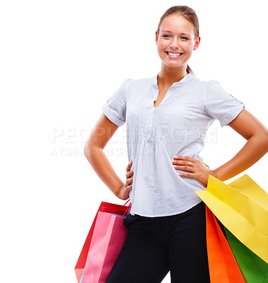 Buy stock photo Portrait of a happy young woman posing with her shopping isolated on white