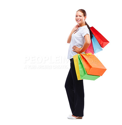 Buy stock photo Full length image of a happy young woman with shopping bags isolated on white