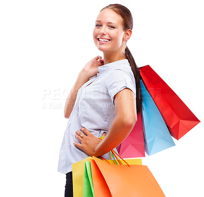 Buy stock photo Portrait of a happy female with shopping isolated on white