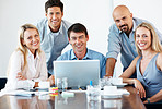 Successful business man with his team smiling at meeting room