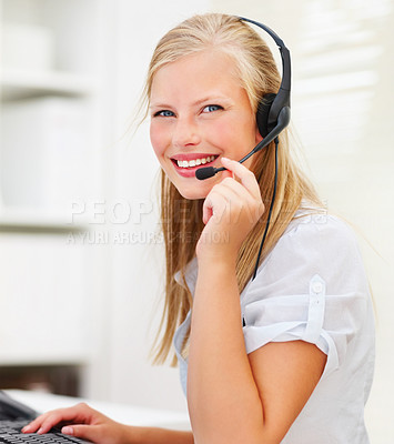 Buy stock photo Happy young woman wearing headphones in office, smiling at you enthusiastically