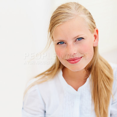 Buy stock photo Closeup portrait of a charming young female smiling against white