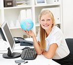 Portrait of a cute business woman with a world globe, sitting at