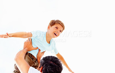 Buy stock photo Adorable small boy being lifted up by his father