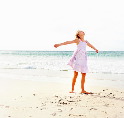 Buy stock photo Young girls enjoying at the beach with her hands outstretched