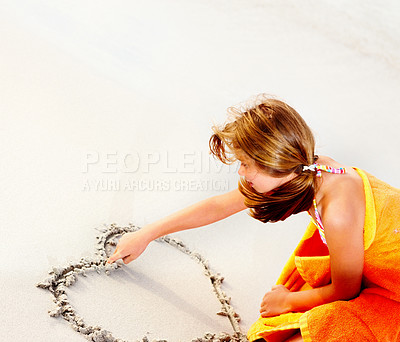 Buy stock photo Beach vacation - Cute young girl drawing a heart on the sand