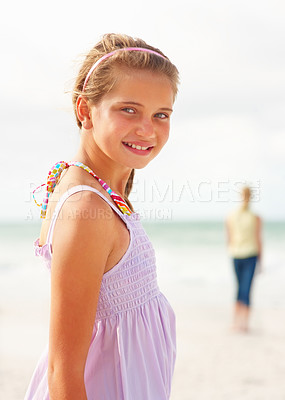 Buy stock photo Portrait of a cute young girl smiling on the beach on a sunny day