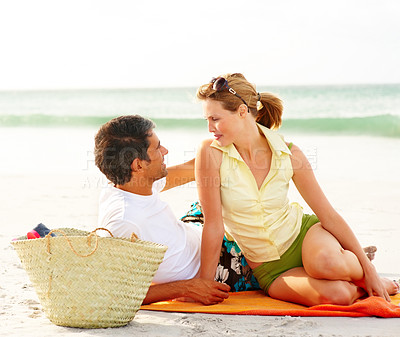 Buy stock photo Picnic - Happy romantic couple relaxing at the beach