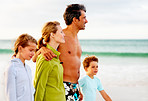 Family on a beach vacation, strolling on the sea shore