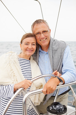 Buy stock photo Portrait of a happy old couple embracing each other on sailboat