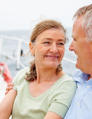 Buy stock photo Pretty mature woman spending a pleasant time with her husband on a sea voyage