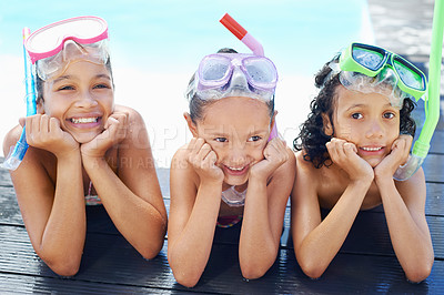 Buy stock photo Three children resting their heads on their hands and waiting to go snorkeling