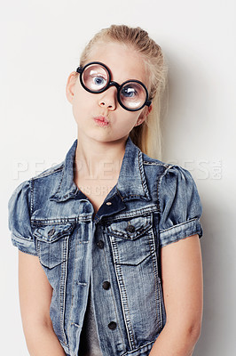 Buy stock photo Portrait of a young girl wearing big round glasses posing in the studio