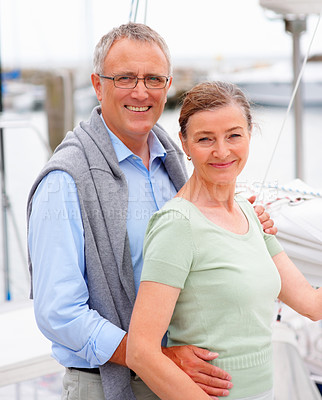 Buy stock photo Portrait of a happy senior couple posing while on a sailboat