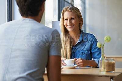 Buy stock photo Cropped shot of an affectionate young couple in a cafe