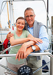 Romantic mature couple on a sea voyage, steering the boat