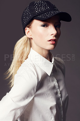 Buy stock photo Portrait of an attractive and stylish young woman posing in the studio