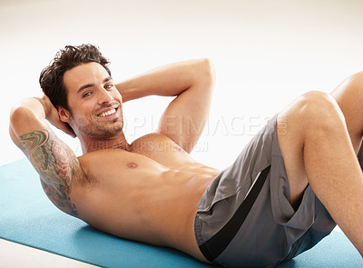 Buy stock photo Portrait of a handsome young man exercising without a shirt