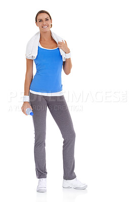 Buy stock photo Healthy young woman holding a bottle of mineral water while isolated on white