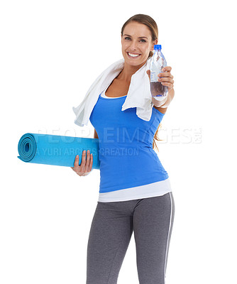 Buy stock photo Fit young woman holding a pilates mat and water bottle with a smile - isolated on white