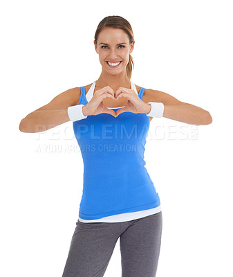 Buy stock photo Young woman in sportswear making a heart shape while isolated on white