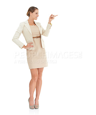 Buy stock photo A beautiful businesswoman pointing towards copyspace against a white background
