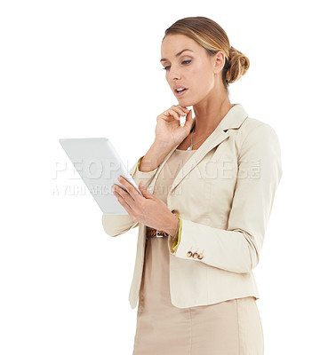 Buy stock photo An attractive business woman looking at a digital tablet
