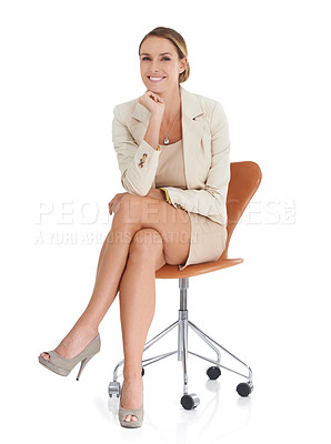 Buy stock photo A beautiful businesswoman sitting on a chair against a white background