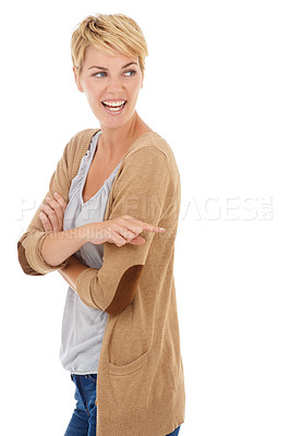 Buy stock photo A pretty young woman pointing towards copyspace while isolated on a white background