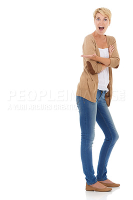 Buy stock photo Full length of an excited young woman pointing towards copyspace